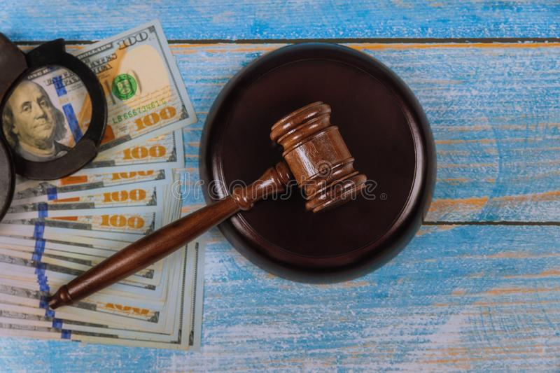 American us dollars of justice judge gavel with handcuffs. American us dollars of justice judge gavel with police handcuffs, lawyer, verdict, legal, crime, court stock photo