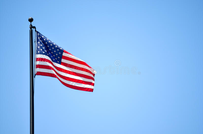 American US Flag. American Flag in a flag pole stock photography