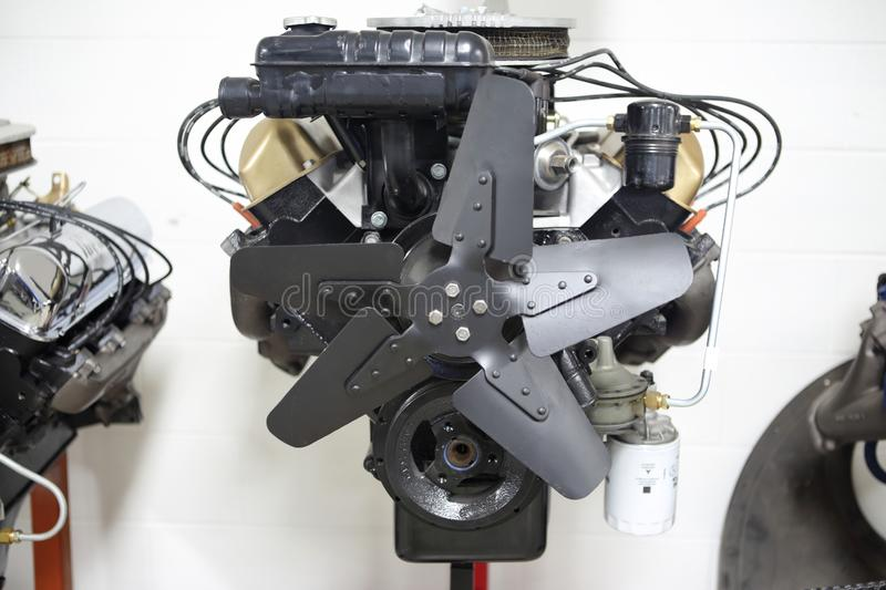 American V8 combustion engine on display. At an automotive shop stock photo