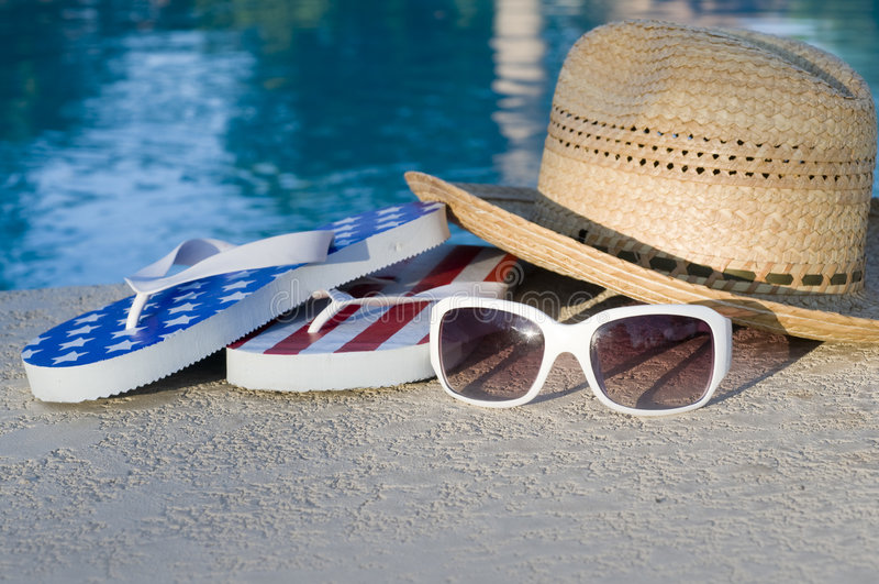 American vacation. Sun hat, white sunglasses and flip flops royalty free stock photography