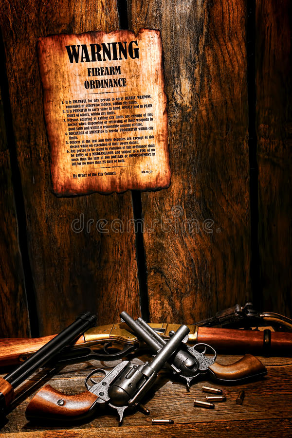 American West Legend Firearm Ordinance and Guns. American West legend old legal firearm ordinance poster with lawful weapon rules posted on sheriff office wood royalty free stock photography