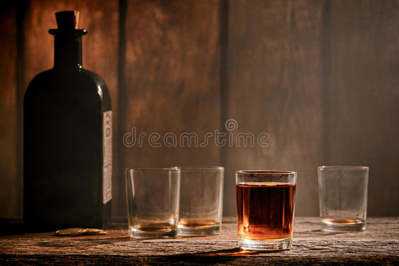 American West Legend Whiskey Glass on Western Bar royalty free stock photo