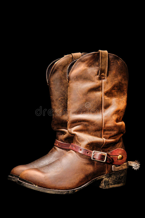 American West Rodeo Cowboy Boots Isolated on Black. American West rodeo cowboy pair of traditional leather roper style western riding boots with authentic stock photos