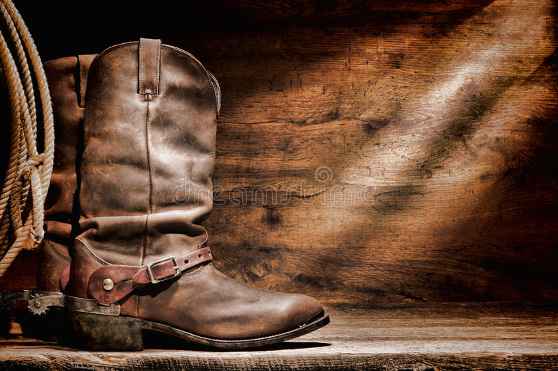 American West Rodeo Cowboy Boots and Western Spurs. American West rodeo cowboy traditional leather working roper boots with authentic Western riding spurs and