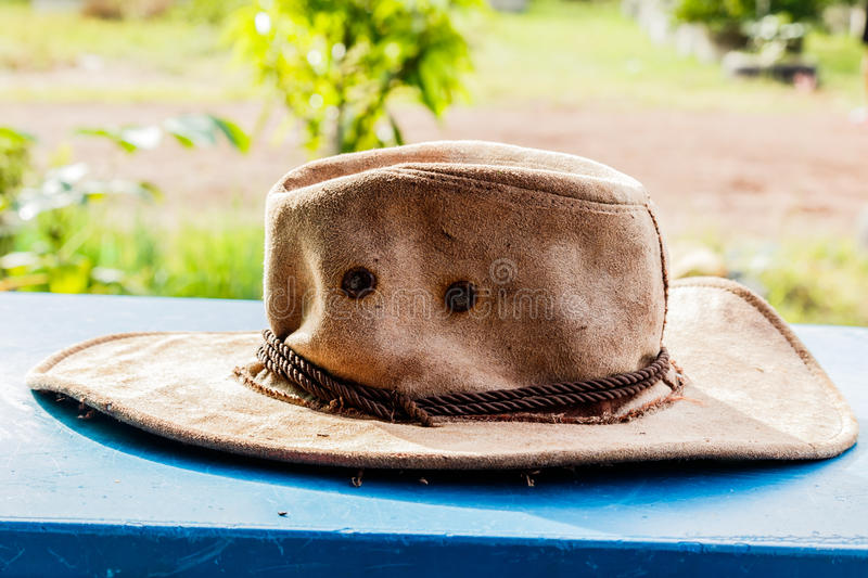 American West rodeo cowboy felt hat and authentic leather western riding boots with vintage ranching gear royalty free stock images