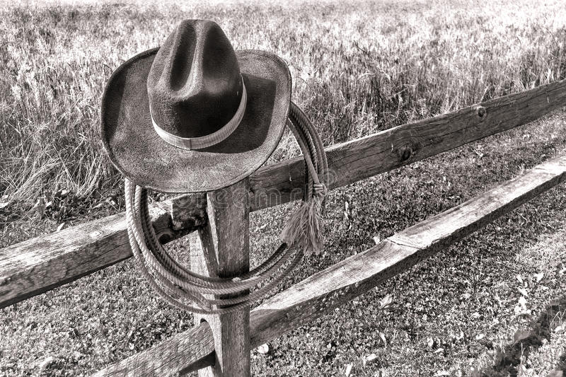 American West Rodeo Cowboy Hat and Lariat on Fence stock images