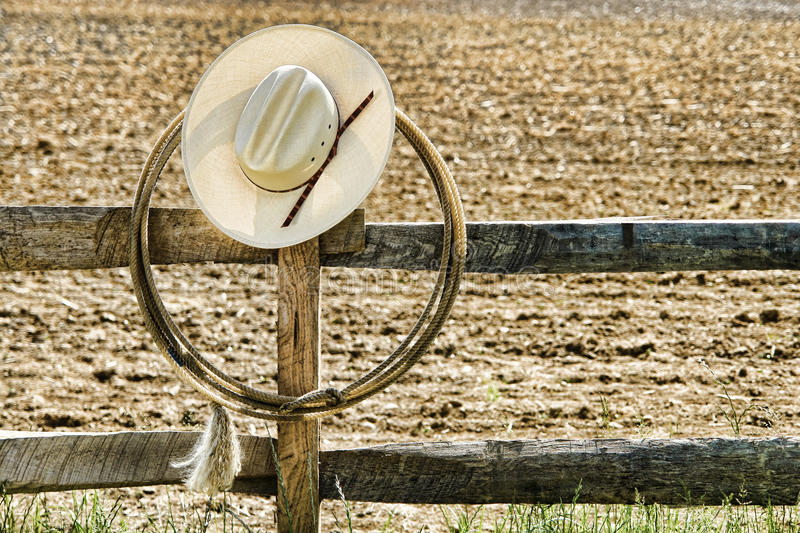 American West Rodeo Cowboy Hat and Lasso on Fence