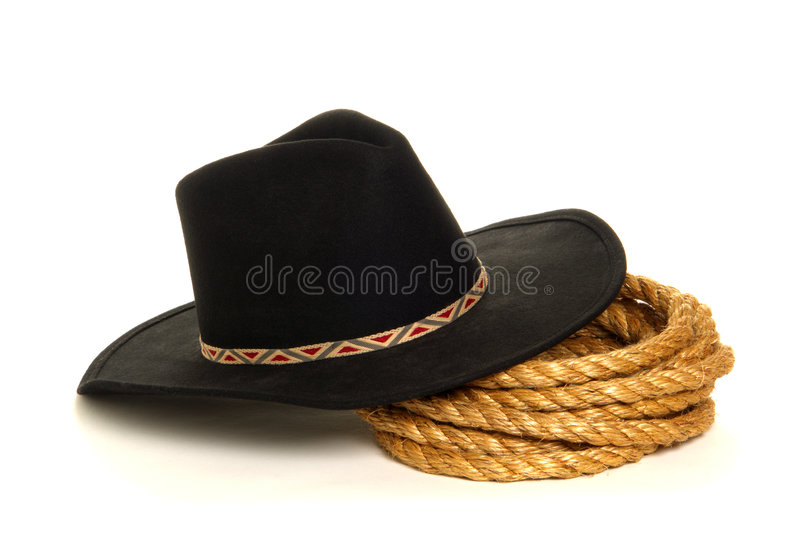 American West Rodeo Cowboy Hat and Ranching Rope. American West rodeo cowboy black felt hat and ranching rope over white stock photos