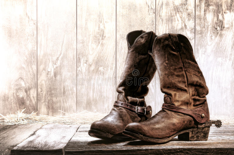 American West Rodeo Old Slouch Roper Cowboy Boots. American West rodeo pair of traditional leather roper style western riding slouch cowboy boots with authentic stock images
