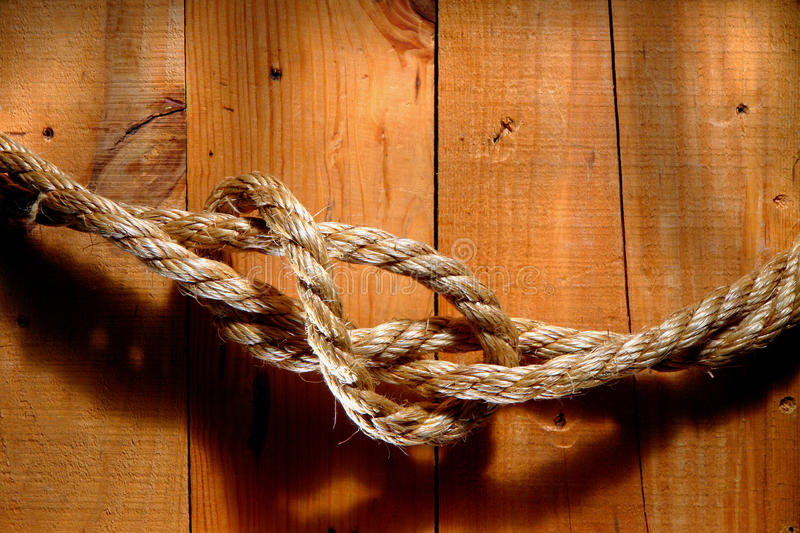 American West Rodeo Rope on Barn Wood. American West old rodeo ranching rope with loop on barn wood stock images