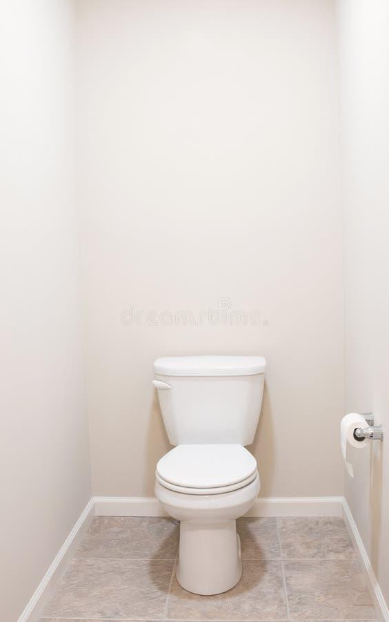 American White Toilet with Tan Tiled Floor royalty free stock photos