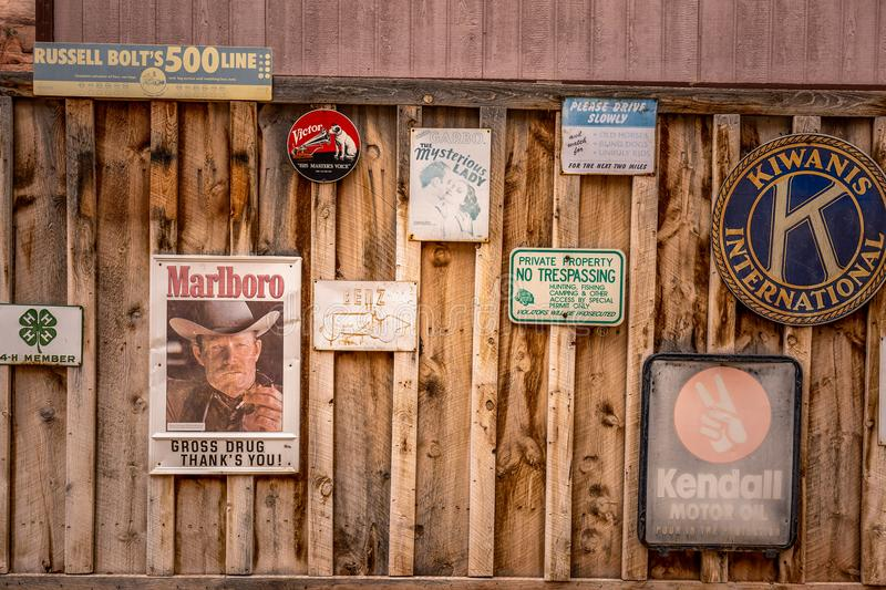 American wild nature. Moab, Utah, USA - January 20, 2018: Old signs and commercials on wooden wall stock image