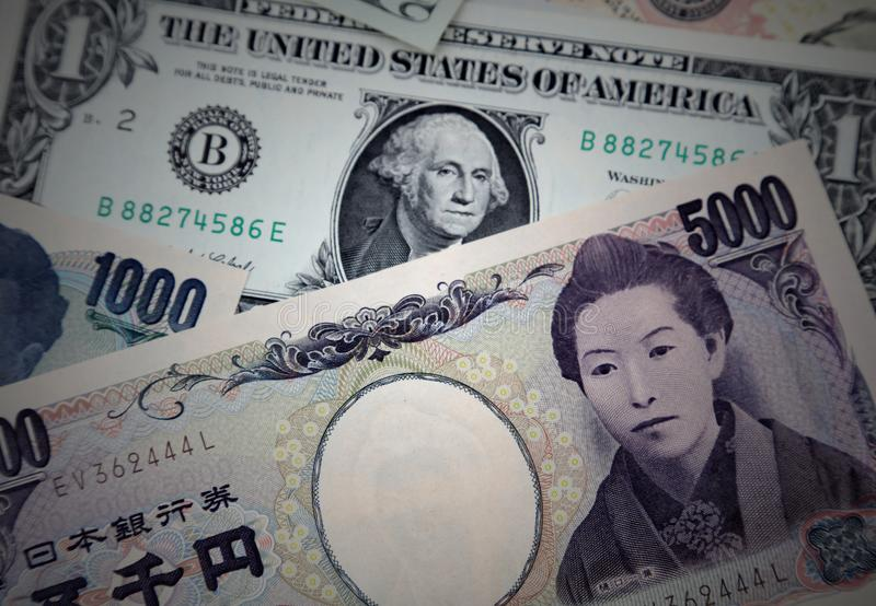 American and Yen banknotes. Close-up of American and Yen banknotes royalty free stock photos