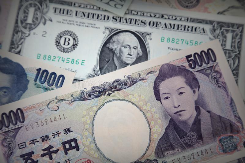 American and Yen banknotes. Close-up of American and Yen banknotes royalty free stock photography