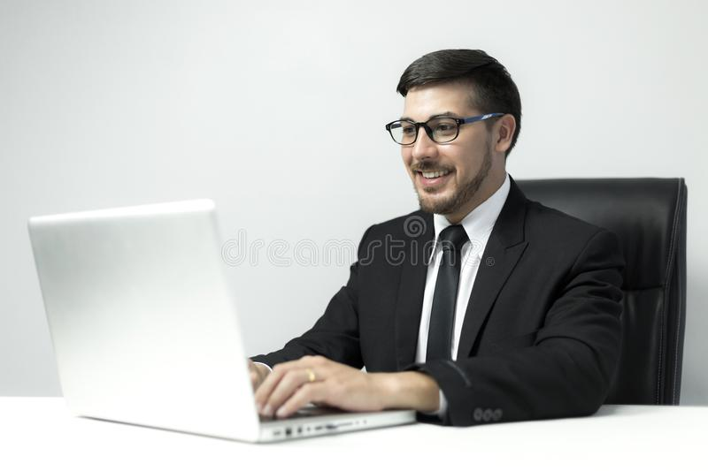American Young businessman working with laptop at office stock images