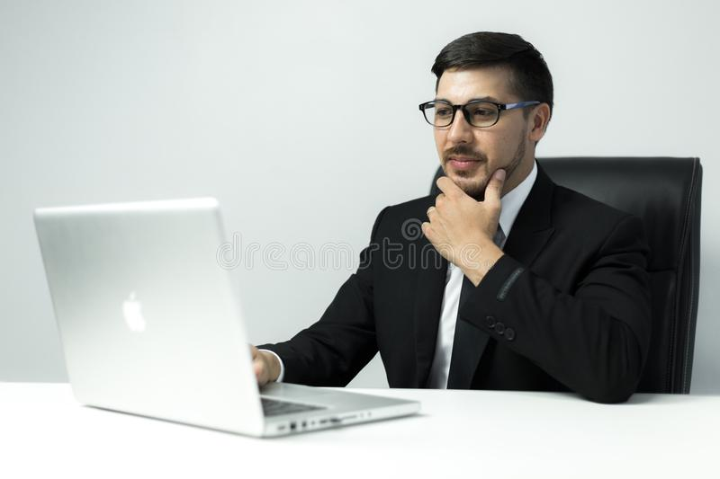 American Young businessman working with laptop at office stock photos