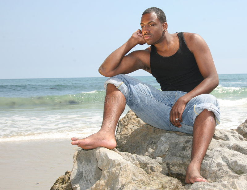 Download American Youth In Deep Thought On The Beach Stock Photo - Image: 5851768
