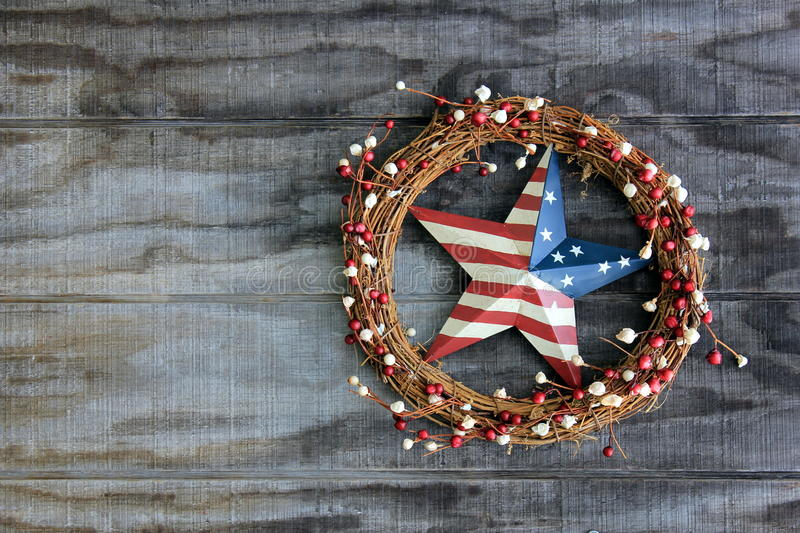 Americana decoration. Pretty americana decoration displayed on the outside gate of a local home stock photos