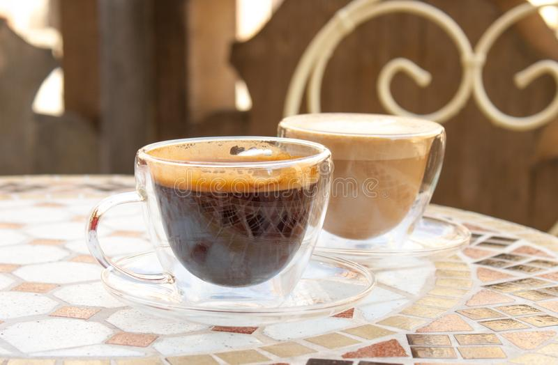 Americano and cappuccino royalty free stock photos