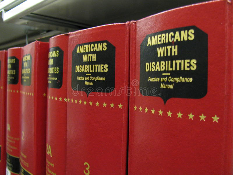 Americanos con los libros del acto de las inhabilidades (ADA) foto de archivo libre de regalías