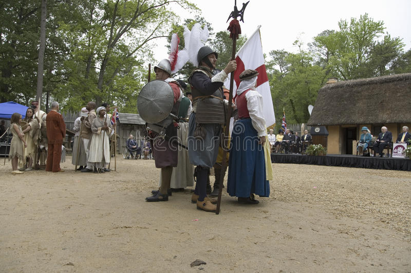 Americans, African slave and English. Native Americans, African slave and English settler reenactors posing as part of the 400th anniversary of the Jamestown stock image