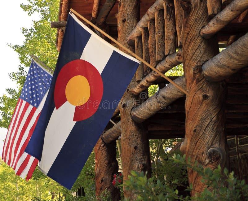 Amerika och Colorado flaggor arkivbild