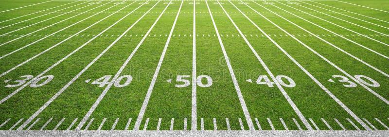 Amerikaans voetbalgebied en gras stock foto