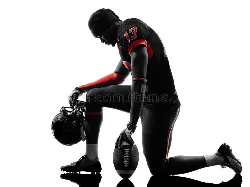 Amerikaans voetbalster het knielen silhouet royalty-vrije stock afbeelding