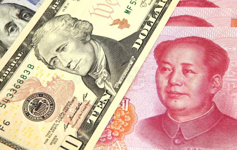 Amerikaanse dollar versus Chinese RMB royalty-vrije stock foto's