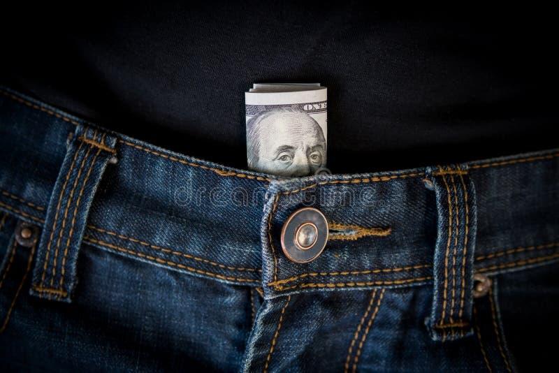Amerikaanse dollarcontant geld in jeanszak stock foto's