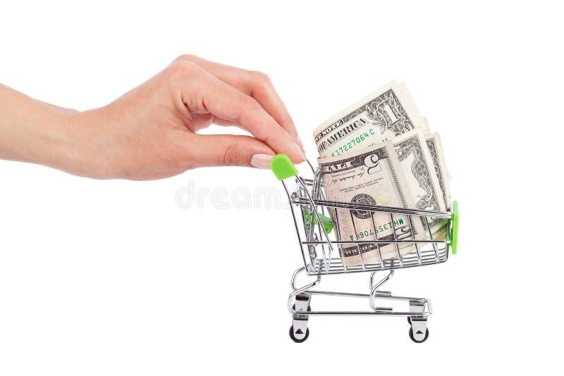 Amerikaanse dollars in de het winkelen geïsoleerde handkar, stock afbeeldingen