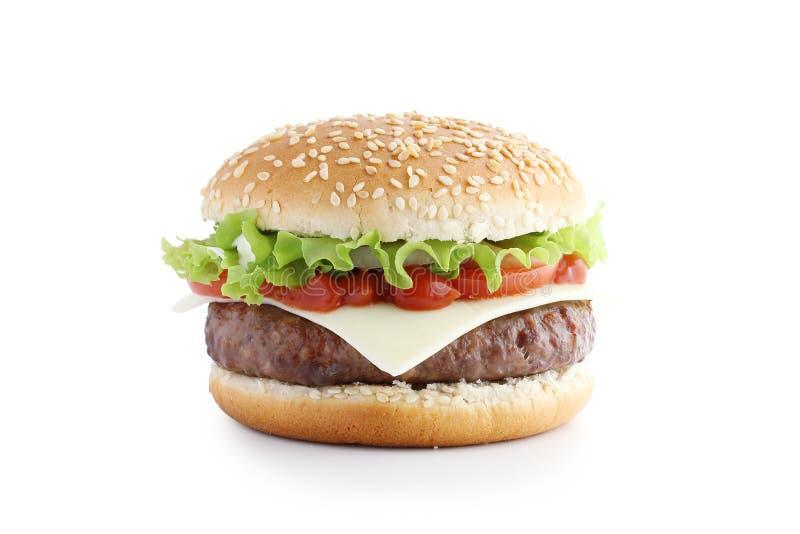 Amerikaanse hamburger met kotelet en groenten stock foto