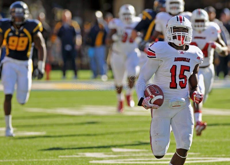 Amerikaanse universiteitsvoetbal - touchdownlooppas royalty-vrije stock fotografie