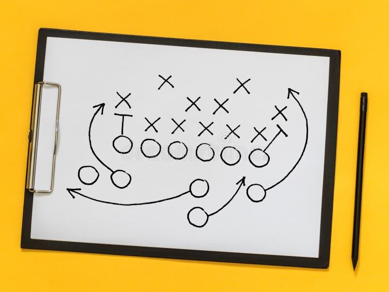 Amerikaanse voetbalstrategie, het trainen, opleiding Spelstrategie S stock afbeelding