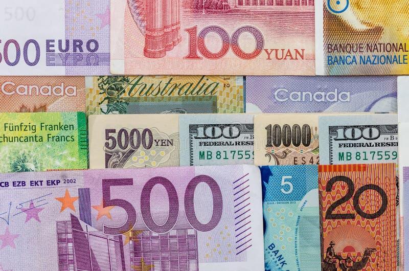 Amerikan oss kanadensisk australisk dollar, euro, japansk yen och kinesYuan sedel royaltyfri foto