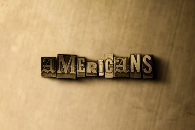 AMERIKANEN - close-up van grungy wijnoogst gezet woord op metaalachtergrond royalty-vrije stock afbeeldingen