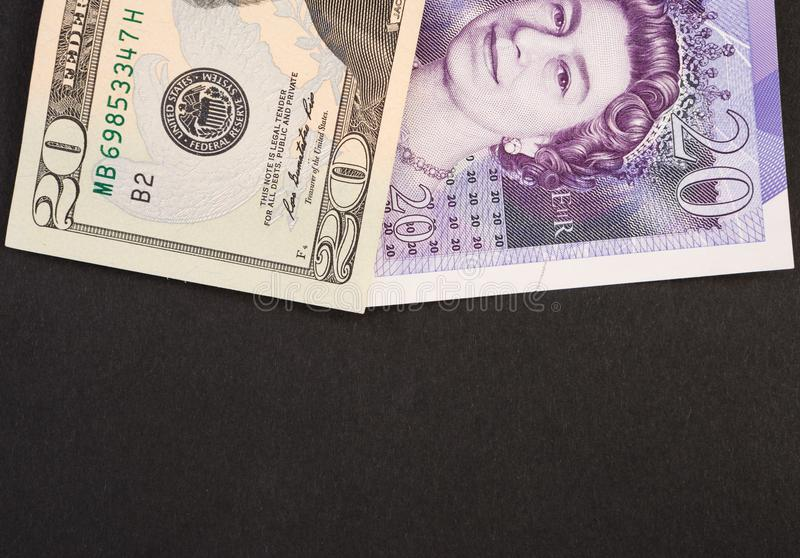 Amerikanische Dollar- und Englischpfundbanknoten stockbild