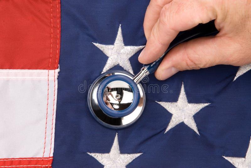 Amerikanische Flagge und Stethoskop stockbilder