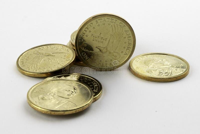 Amerikanische Münzen auf einem weißen Hintergrund stockbilder