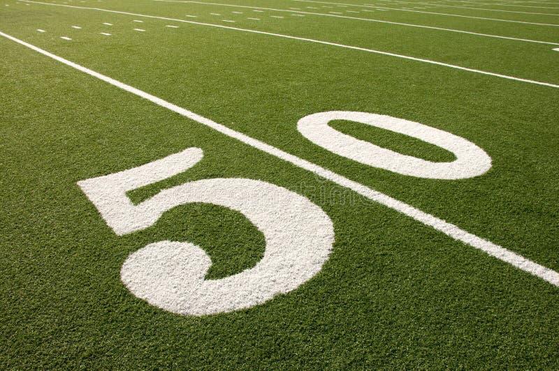 Amerikanische Yard-Line des Fußballplatz-50 lizenzfreie stockfotografie