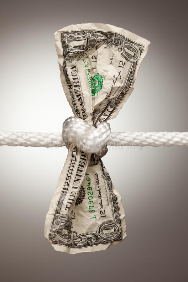 Amerikanischer Dollar gebunden im Seil stockfoto