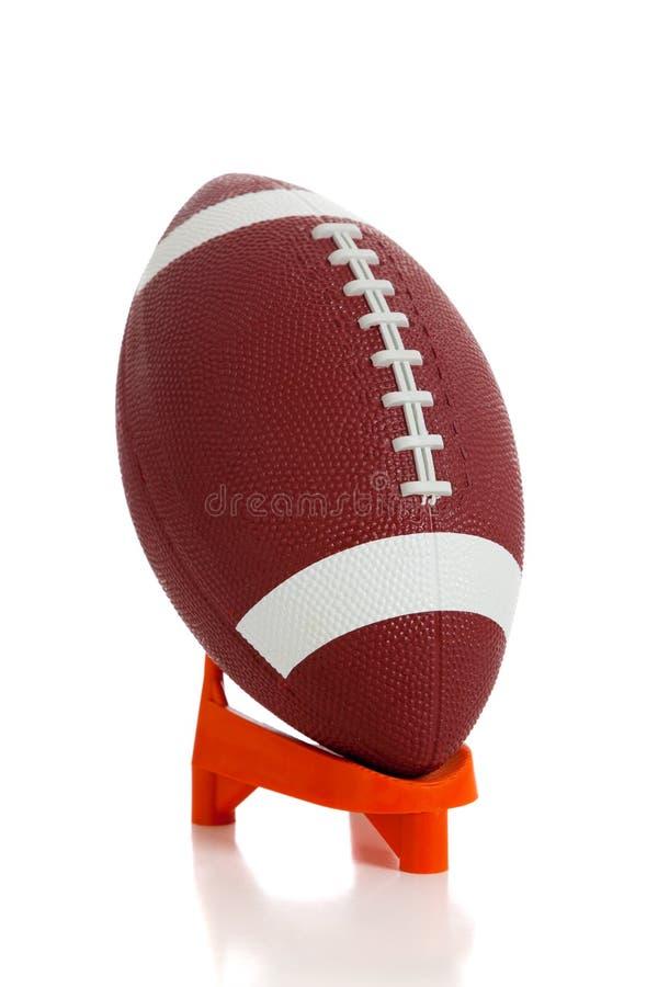 Amerikanischer Fußball und T-Stück lizenzfreies stockfoto