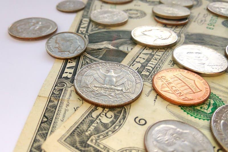 Amerikanischer Groschen, Viertelcents und Penny-USA-Münzen auf Dollar-USA-Hintergrund lizenzfreie stockbilder