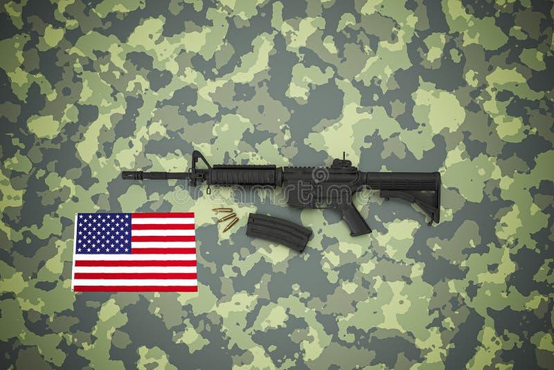 Amerikanischer Kaliber 5 56 mm Gewehr auf Tarnuntergrund stockfotos