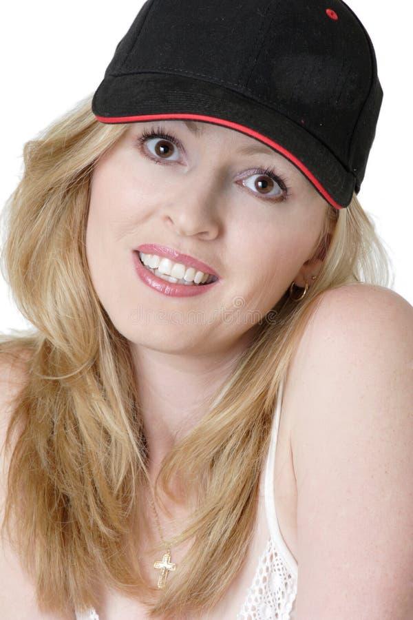 Amerikanisches Mädchen in der Baseballmütze stockbild