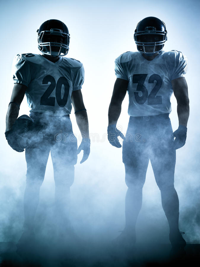amerikansk fotbollsspelaresilhouette arkivfoto
