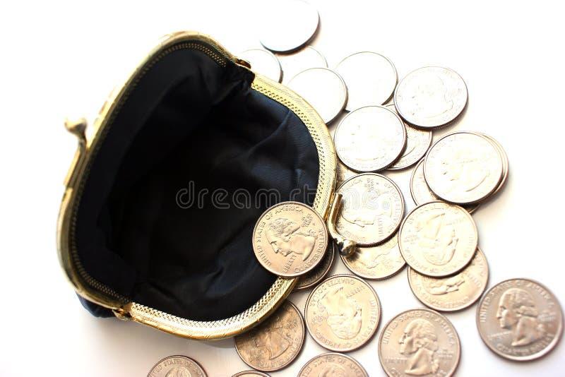 Amerikanska dollar i ett mynt börs på en vit bakgrund Närbild arkivbilder