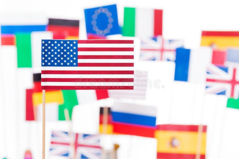 Amerikanska flaggan mot flaggor av EU-medlemsstater royaltyfria foton