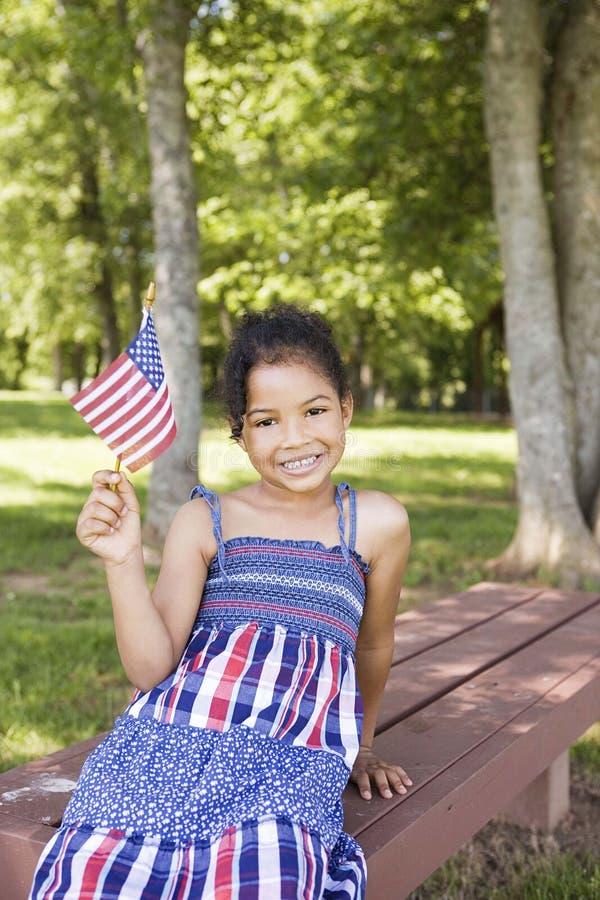 amerikanska flagganflicka little som vågr arkivbilder