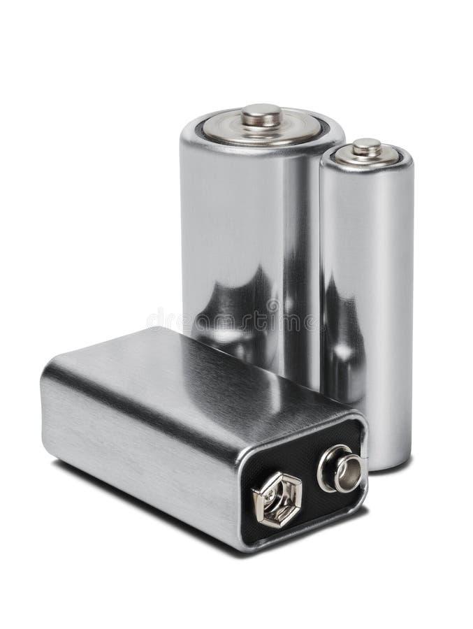 amerikanska motorförbundet, motorförbundet och PP3 för tre batterier på vit isolerade bakgrund Begrepp av förnybara energikällor  royaltyfri foto